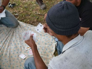 """Migrants play """"casino."""" Photo by author."""