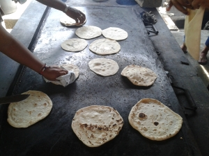 Hondurans prepared baleadas for dinner - a flour tortilla folded over and filled with beans, cream, cheese and scrambled eggs.